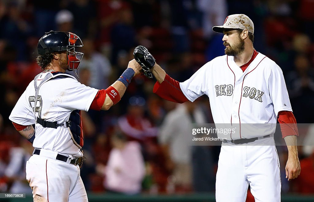 <a gi-track='captionPersonalityLinkClicked' href=/galleries/search?phrase=Andrew+Miller+-+Baseball+Player&family=editorial&specificpeople=4496823 ng-click='$event.stopPropagation()'>Andrew Miller</a> #30 of the Boston Red Sox is congratulated by teammate <a gi-track='captionPersonalityLinkClicked' href=/galleries/search?phrase=Jarrod+Saltalamacchia&family=editorial&specificpeople=836404 ng-click='$event.stopPropagation()'>Jarrod Saltalamacchia</a> #39 of the Boston Red Sox following their 9-3 win against the Philadelphia Phillies during the interleague game on May 27, 2013 at Fenway Park in Boston, Massachusetts.