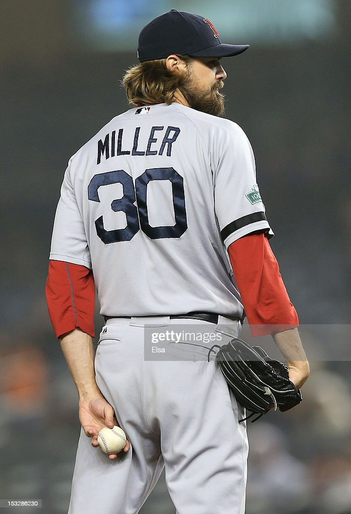 <a gi-track='captionPersonalityLinkClicked' href=/galleries/search?phrase=Andrew+Miller+-+Baseball+Player&family=editorial&specificpeople=4496823 ng-click='$event.stopPropagation()'>Andrew Miller</a> #30 of the Boston Red Sox looks for the signal in the bottom of the 12th inning against the New York Yankees on October 2, 2012 at Yankee Stadium in the Bronx borough of New York City. The New York Yankees defeated the Boston Red Sox 4-3 in 12 innings.