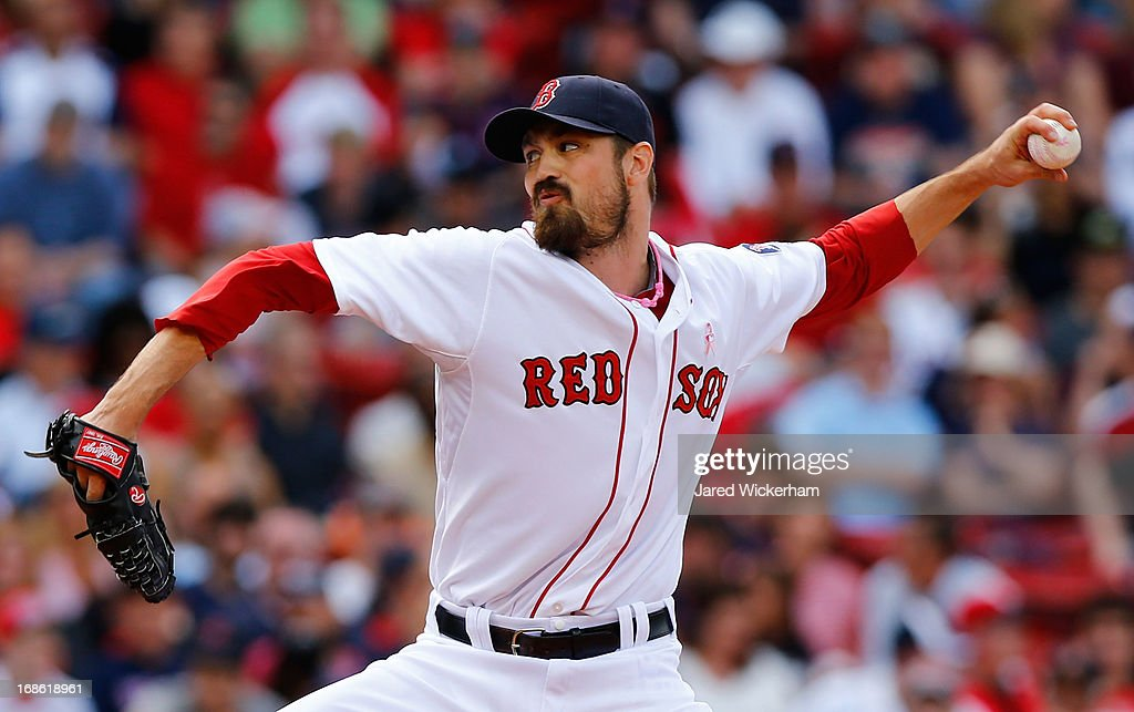 Andrew Miller #30 of the Boston Red Sox pitches against the Toronto Blue Jays during the game on May 12, 2013 at Fenway Park in Boston, Massachusetts.