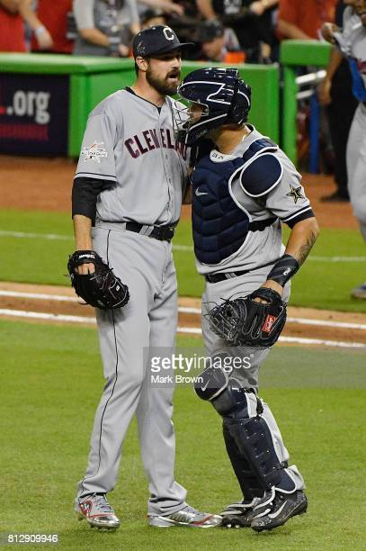 Andrew Miller of the Cleveland Indians and the American League and Gary Sanchez of the New York Yankees and the American League celebrate defeating...