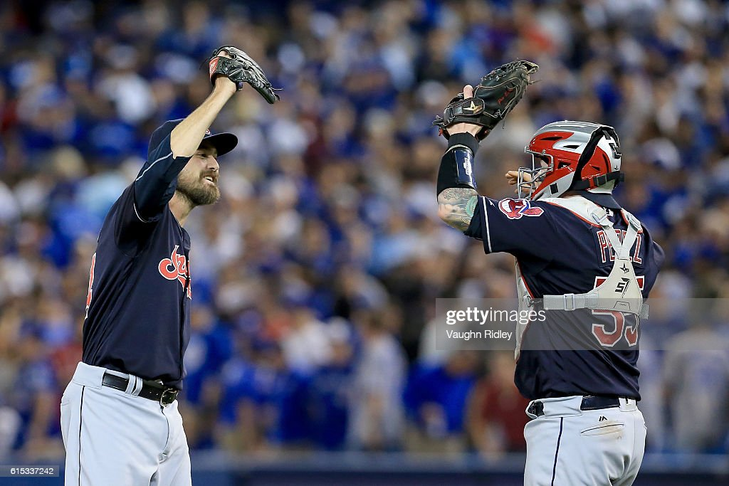 Andrew Miller #24 of the Cleveland Indians celebrates with teammate Roberto Perez #55 after defeating the Toronto Blue Jays with a score of 4 to 2 in game three of the American League Championship Series at Rogers Centre on October 17, 2016 in Toronto, Canada.
