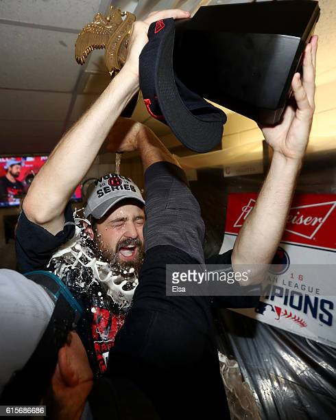 Andrew Miller of the Cleveland Indians celebrates with the William Harridge Award in the locker room after defeating the Toronto Blue Jays with a...