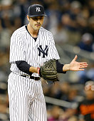 Andrew Miller of the New York Yankees celebrates the win over the Baltimore Orioles on May 8 2015 at Yankee Stadium in the Bronx borough of New York...