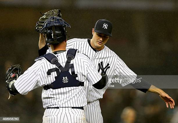 Andrew Miller of the New York Yankees celebrates the win with teamamte Brian McCann after the game against the Toronto Blue Jays on April 8 2015 at...
