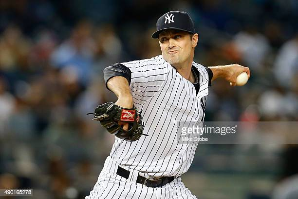 Andrew Miller of the New York Yankees pitches in the ninth inning against the Chicago White Sox at Yankee Stadium on September 26 2015 in the Bronx...