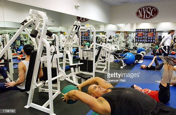 Andrew Mitchell exercises with a medicine ball at a New York Sports Club January 2 2003 in Brooklyn New York Thousands of people around the country...