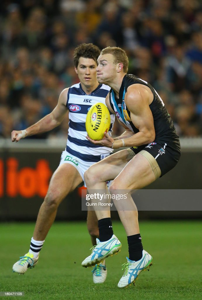 Andrew Moore of the Power marks during the Second Semi Final match between the Geelong Cats and the Port Adelaide Power at Melbourne Cricket Ground on September 13, 2013 in Melbourne, Australia.
