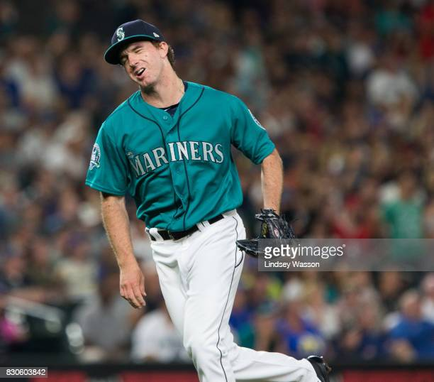 Andrew Moore of the Seattle Mariners grimaces after giving up a basesloaded single to Albert Pujols of the Los Angeles Angels of Anaheim scoring two...