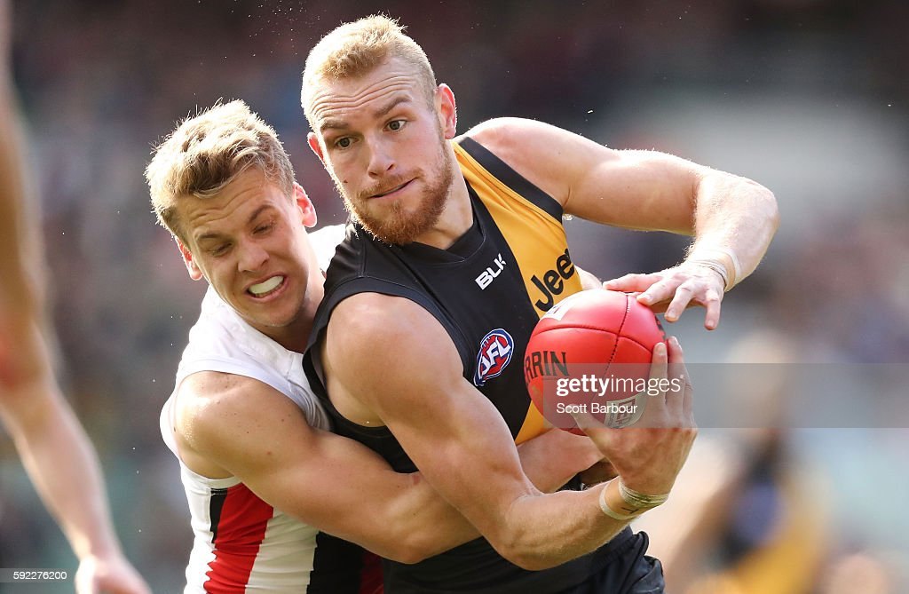 Andrew Moore of the Tigers is tackled during the round 22 AFL match between the Richmond Tigers and the St Kilda Saints at Melbourne Cricket Ground...