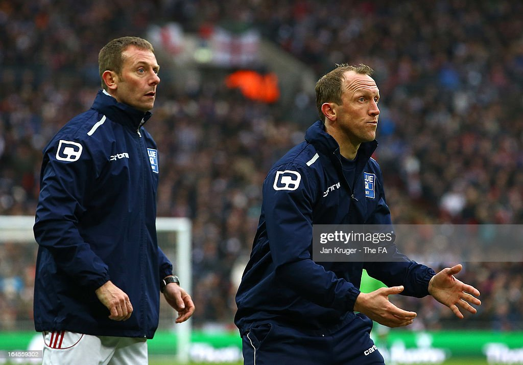 Andrew Morrell, Player/ Manager(R) and Billy Barr, Assistant Manager of Wrexham look on during the FA Trophy Final between Wrexham and Grimsby Town at Wembley Stadium on March 24, 2013 in London, England.