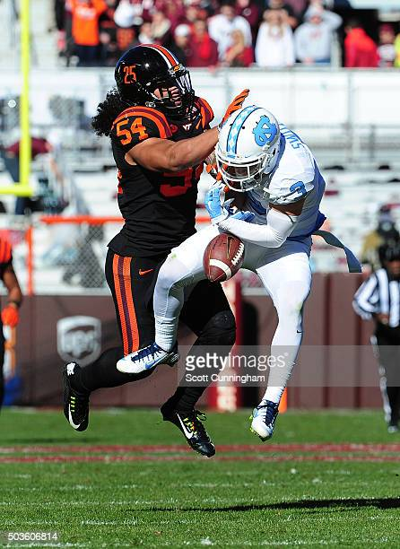 Andrew Motuapuaka of the Virginia Tech Hokies breaks up a pass intended for Ryan Switzer of the North Carolina Tar Heels on November 21 2015 at Lane...
