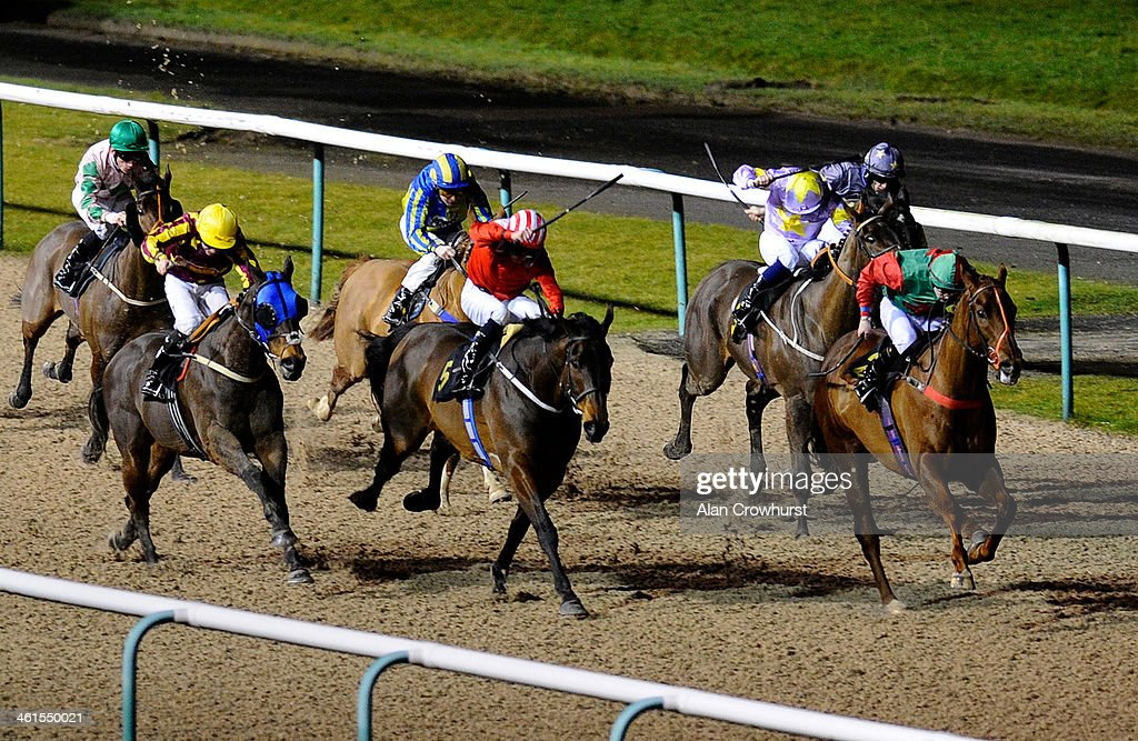 Andrew Mullen riding Khajaaly win The Download The Ladbrokes App Handicap Stakes at Wolverhampton racecourse on January 09 2014 in Wolverhampton...