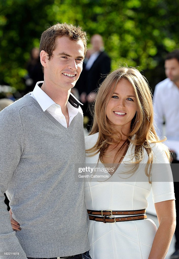 Andrew Murray and Kim Sears arrive at the Burberry Spring Summer 2013 Womenswear Show at Kensington Gardens on September 17, 2012 in London, England.