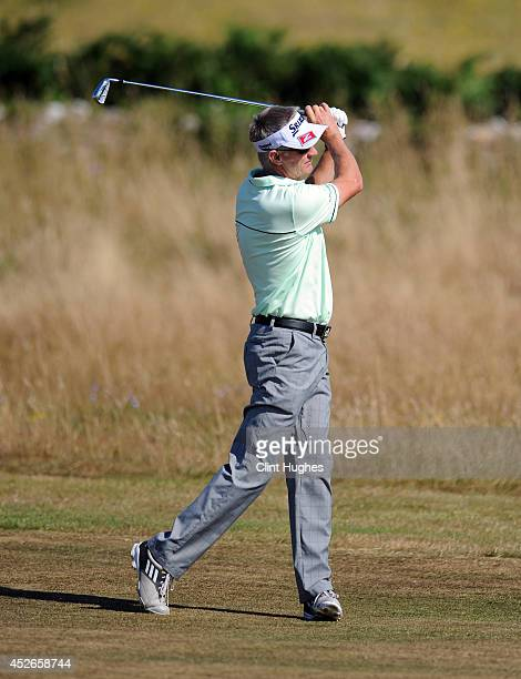 Andrew Murray of England makes an approach shot on the 6th hole during the second round of the Senior Open Championship at Royal Porthcawl Golf Club...