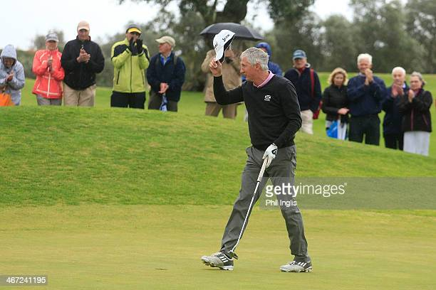 Andrew Murray of England salutes the crowd on the 18th green during the final round of the European Senior Tour Qualifying School Finals played at...