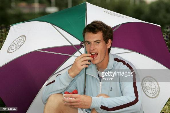 Andrew Murray of Great Britain tries a taste of some traditional Wimbledon strawberries and cream during the fifth day of the Wimbledon Lawn Tennis...