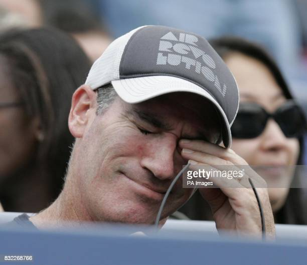 Andrew Murray's coach Brad Gilbert watches his young prodigy in action against Nikolay Davydenko during their 4th round match during the US Open in...