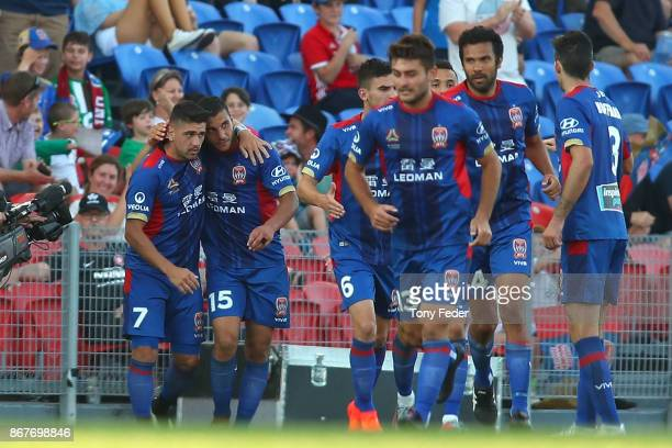 Andrew Nabbout and Dimitri Petratos of the Jets celebrate a goal during the round four ALeague match between the Newcastle Jets and the Western...