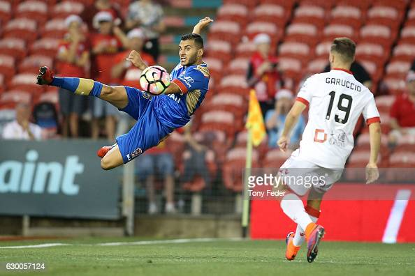 Andrew Nabbout of the Jets attempts to keep the ball in play during the round 11 ALeague match between the Newcastle Jets and Adelaide United at...