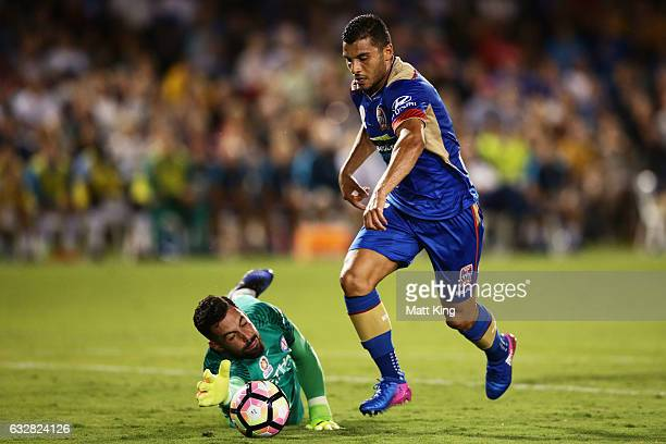 Andrew Nabbout of the Jets beats Melbourne City goalkeeper Dean Bouzanis to score the first goal during the round 17 ALeague match between the...