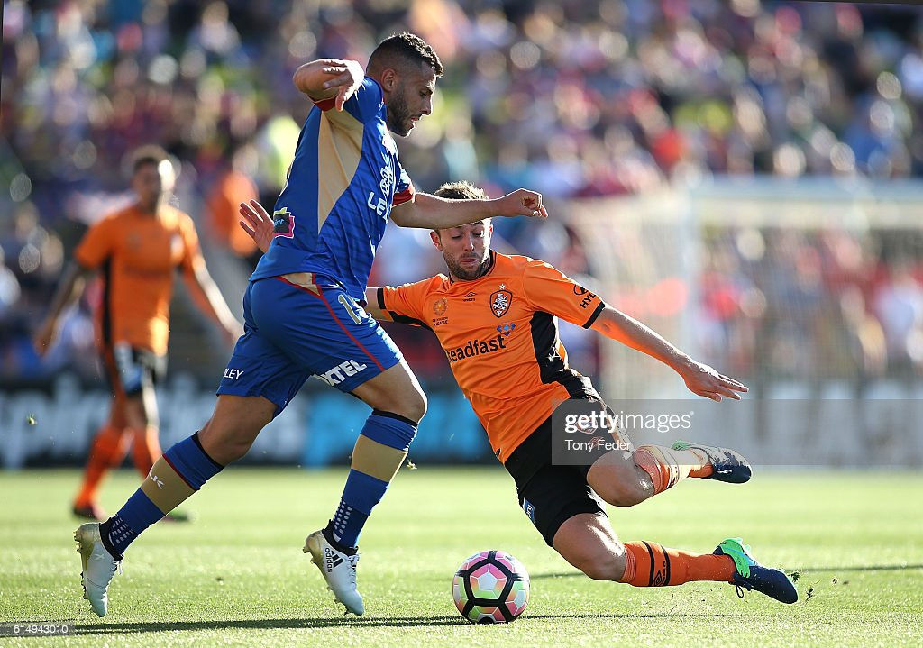 Andrew Nabbout of the Jets contests the ball with Thomas Oar of the Roar during the round two A-League match between the Newcastle Jets and the Brisbane Roar at Hunter Stadium on October 16, 2016 in Newcastle, Australia.