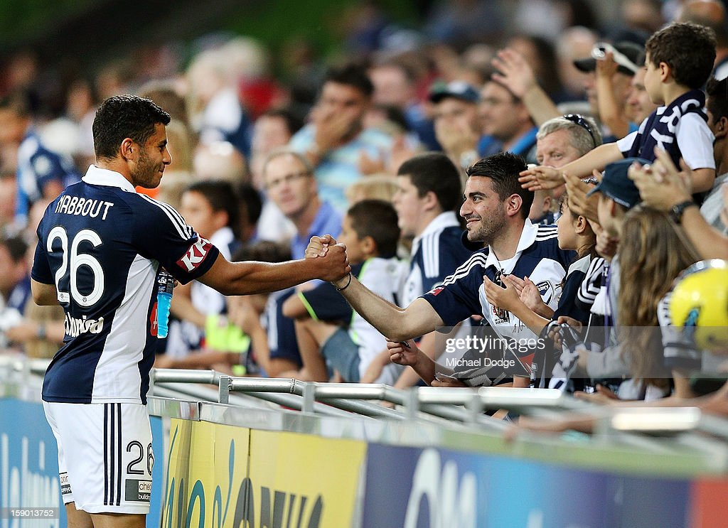 Andrew Nabbout of the Melbourne Victory thanks a Victory fan after their win during the round 15 A-League match between the Melbourne Victory and Wellington Phoenix at AAMI Park on January 5, 2013 in Melbourne, Australia.