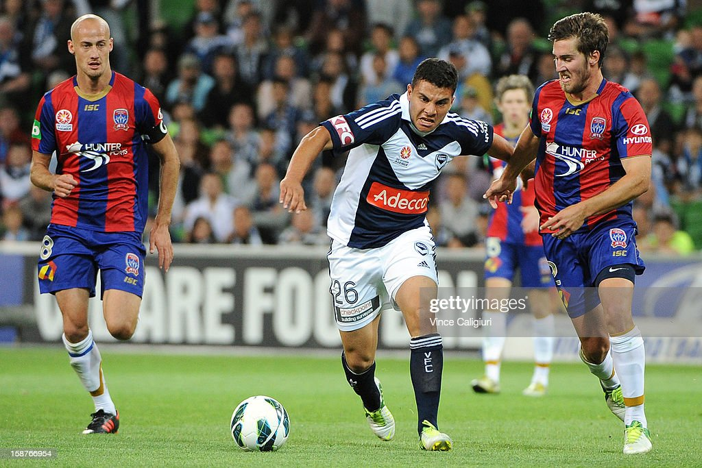 Andrew Nabbout of the Victory controls the ball from Joshua Brillante of the Jets during the round 13 A-League match between the Melbourne Victory and the Newcastle Jets at AAMI Park on December 28, 2012 in Melbourne, Australia.