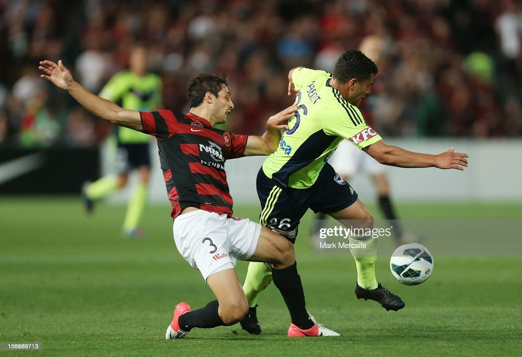 Andrew Nabbout of the Victory is challenged by Adam D'Appuzo of the Wanderers during the round eight A-League match between the Western Sydney Wanderers and the Melbourne Victory at Parramatta Stadium on November 24, 2012 in Sydney, Australia.