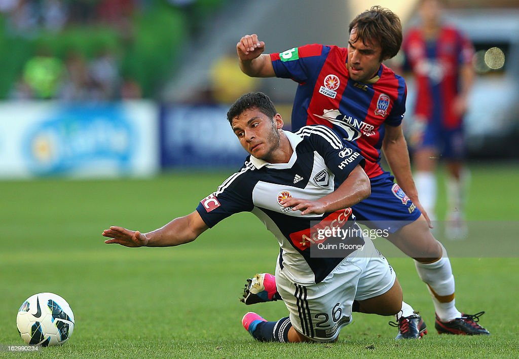 Andrew Nabbout of the Victory is tackled by <a gi-track='captionPersonalityLinkClicked' href=/galleries/search?phrase=Bernardo+Ribeiro&family=editorial&specificpeople=9767486 ng-click='$event.stopPropagation()'>Bernardo Ribeiro</a> of the Jets during the round 23 A-League match between the Melbourne Victory and the Newcastle Jets at AAMI Park on March 3, 2013 in Melbourne, Australia.
