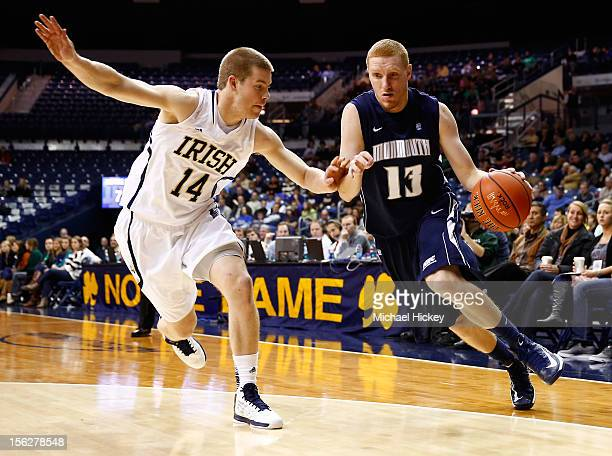 Andrew Nicholas of the Monmouth Hawks dribbles the ball against Scott Martin of the Notre Dame Fighting Irish at Purcel Pavilion on November 12 2012...