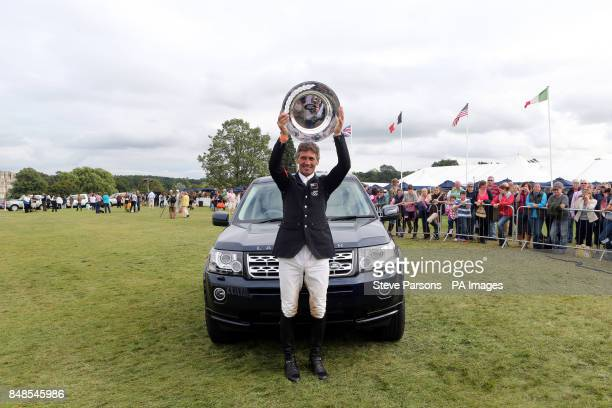 Andrew Nicholson celebrates winning the Burghley Horse Trials at Burghley Park Stamford