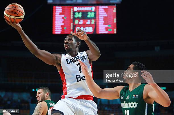 Andrew Nicholson of Canada goes up against Gabriel Giron of Mexico during a third place match between Canada and Mexico as part of the 2015 FIBA...