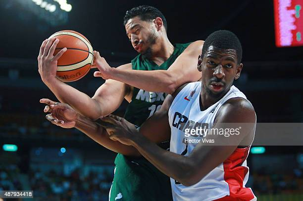 Andrew Nicholson of Canada handles the ball against Gabriel Giron of Mexico during a third place match between Canada and Mexico as part of the 2015...