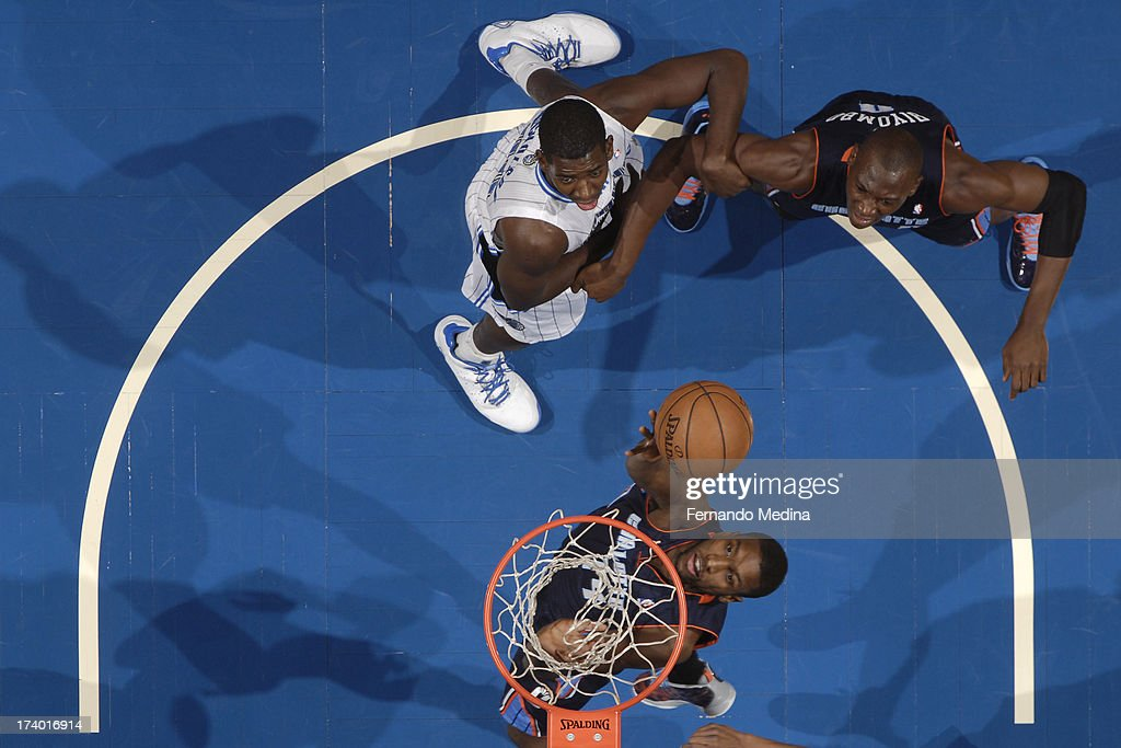 Andrew Nicholson #44 of the Orlando Magic and <a gi-track='captionPersonalityLinkClicked' href=/galleries/search?phrase=Bismack+Biyombo&family=editorial&specificpeople=7640443 ng-click='$event.stopPropagation()'>Bismack Biyombo</a> #0 of the Charlotte Bobcats battle for position while <a gi-track='captionPersonalityLinkClicked' href=/galleries/search?phrase=Michael+Kidd-Gilchrist&family=editorial&specificpeople=8526214 ng-click='$event.stopPropagation()'>Michael Kidd-Gilchrist</a> #14 of the Charlotte Bobcats shoots a layup during the game on February 19, 2013 at Amway Center in Orlando, Florida.