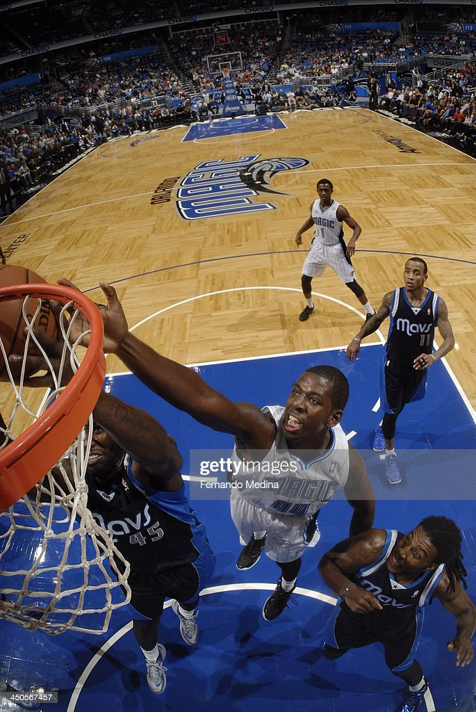 Andrew Nicholson #44 of the Orlando Magic attempts to block a shot against <a gi-track='captionPersonalityLinkClicked' href=/galleries/search?phrase=DeJuan+Blair&family=editorial&specificpeople=4649451 ng-click='$event.stopPropagation()'>DeJuan Blair</a> #45 of the Dallas Mavericks on November 16, 2013 at Amway Center in Orlando, Florida.