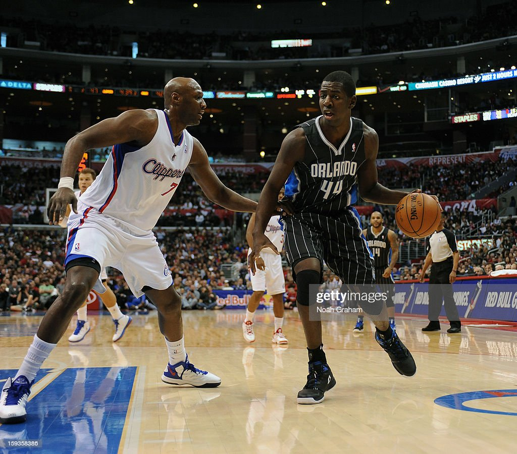 Andrew Nicholson #44 of the Orlando Magic dribbles against Lamar Odom #7 of the Los Angeles Clippers at Staples Center on January 12, 2013 in Los Angeles, California.