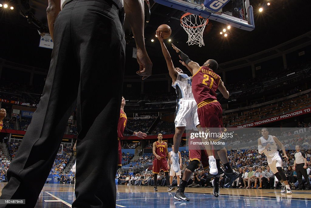 Andrew Nicholson #44 of the Orlando Magic goes to the basket against Wayne Ellington #21 of the Cleveland Cavaliers during the game between the Cleveland Cavaliers and the Orlando Magic on February 23, 2013 at Amway Center in Orlando, Florida.