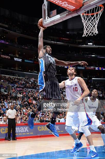 Andrew Nicholson of the Orlando Magic goes to the basket against Spencer Hawes of the Los Angeles Clippers on December 3 2014 at Staples Center in...