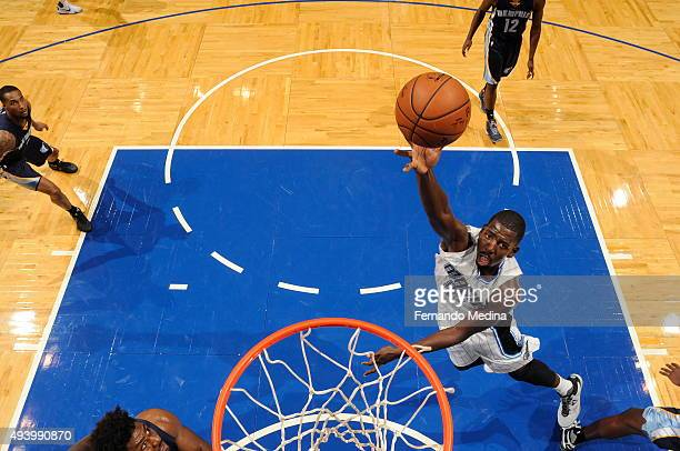 Andrew Nicholson of the Orlando Magic goes to the basket against the Memphis Grizzlies on October 23 2015 at Amway Center in Orlando Florida NOTE TO...