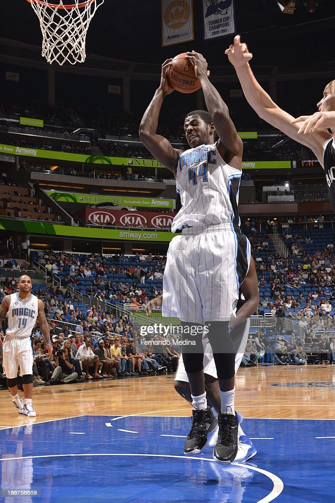 Andrew Nicholson #44 of the Orlando Magic grabs a rebound against the Brooklyn Nets on November 3, 2013 at Amway Center in Orlando, Florida.