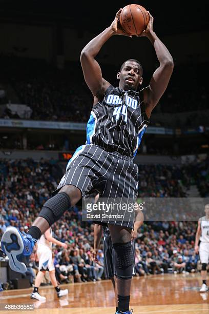 Andrew Nicholson of the Orlando Magic grabs the rebound against the Minnesota Timberwolves on April 3 2015 at Target Center in Minneapolis Minnesota...