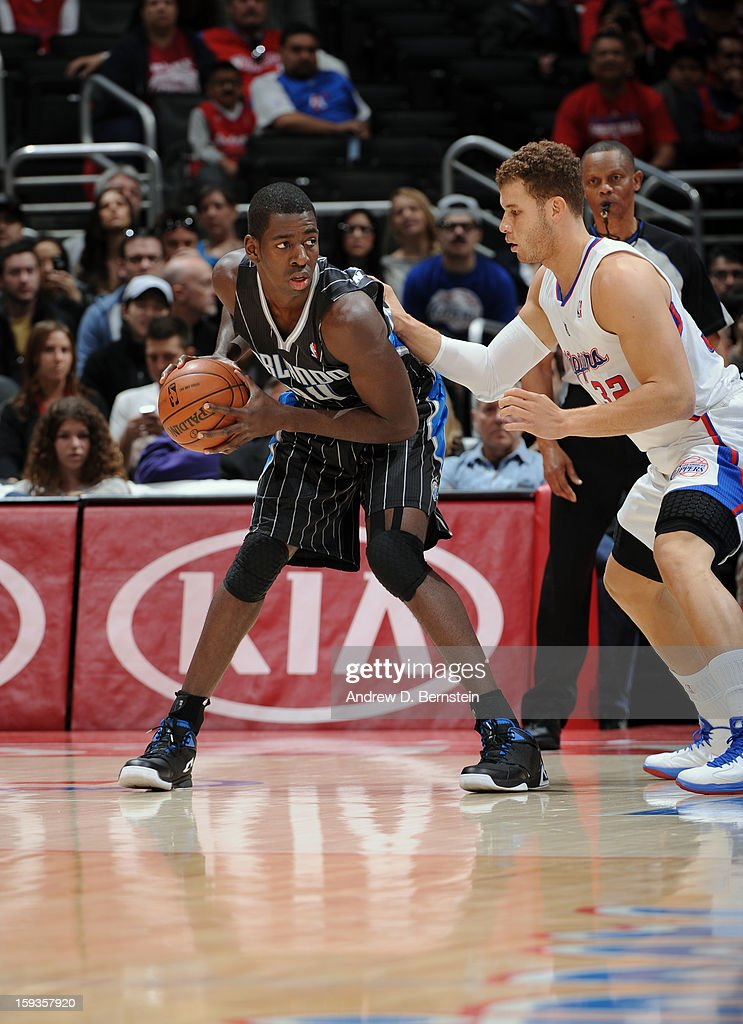 Andrew Nicholson #44 of the Orlando Magic looks to pass the ball against Blake Griffin #32 of the Los Angeles Clippers at Staples Center on January 12, 2013 in Los Angeles, California.