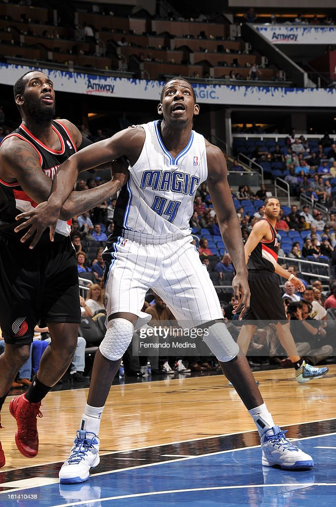 Andrew Nicholson #44 of the Orlando Magic looks to rebound against J.J. Hickson #21 of the Portland Trail Blazers on February 10, 2013 at Amway Center in Orlando, Florida.