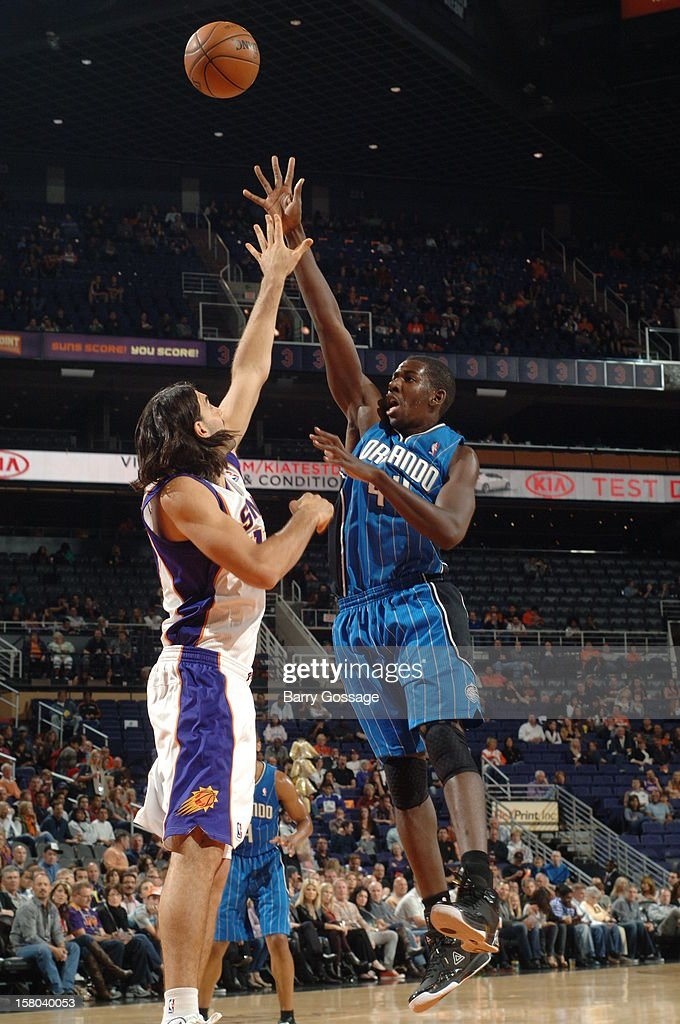 Andrew Nicholson #44 of the Orlando Magic puts a shot up over the block of Luis Scola #14 of the Phoenix Suns on December 9, 2012 at U.S. Airways Center in Phoenix, Arizona.