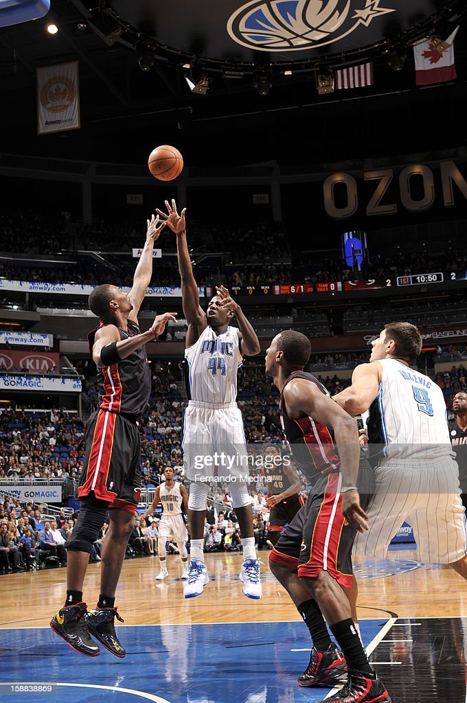 Andrew Nicholson #44 of the Orlando Magic puts up the shot against Chris Bosh #1 of the Miami Heat during the game on December 31, 2012 at Amway Center in Orlando, Florida.