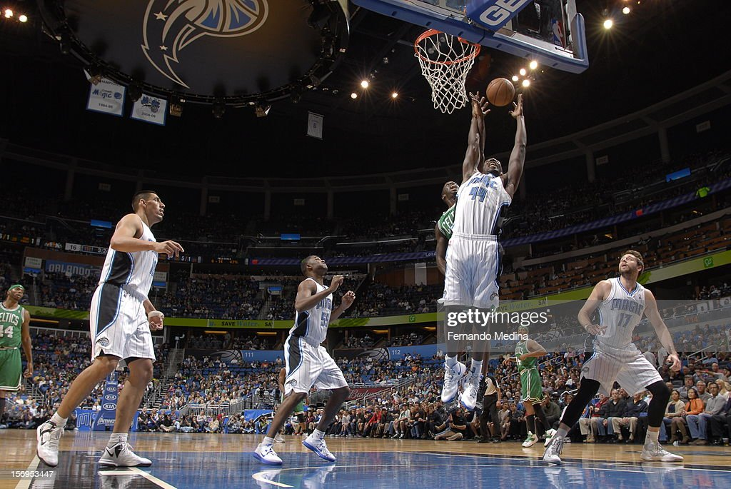 Andrew Nicholson #44 of the Orlando Magic reaches for the ball against defense of Brandon Bass #30 of the Boston Celtics during the game between the Boston Celtics and the Orlando Magic on November 25, 2012 at Amway Center in Orlando, Florida.