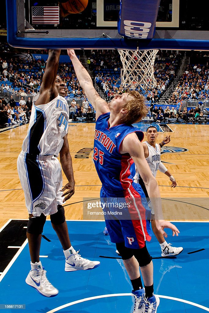 Andrew Nicholson #44 of the Orlando Magic rises for a dunk against Kyle Singler #25 of the Detroit Pistons on November 21, 2012 at Amway Center in Orlando, Florida.