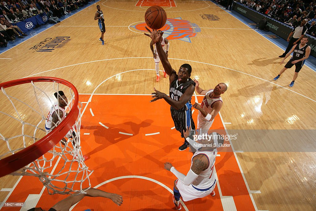 Andrew Nicholson #44 of the Orlando Magic shoots against <a gi-track='captionPersonalityLinkClicked' href=/galleries/search?phrase=Carmelo+Anthony&family=editorial&specificpeople=201494 ng-click='$event.stopPropagation()'>Carmelo Anthony</a> #7 of the New York Knicks on March 20, 2013 at Madison Square Garden in New York City.