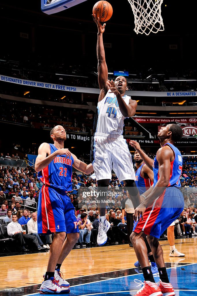 Andrew Nicholson #44 of the Orlando Magic shoots in the lane against Brandon Knight #7 and Tayshaun Prince #22 of the Detroit Pistons on November 21, 2012 at Amway Center in Orlando, Florida.
