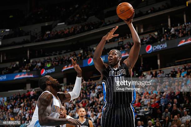 Andrew Nicholson of the Orlando Magic takes a shot over JJ Hickson of the Denver Nuggets at Pepsi Center on January 7 2015 in Denver Colorado The...
